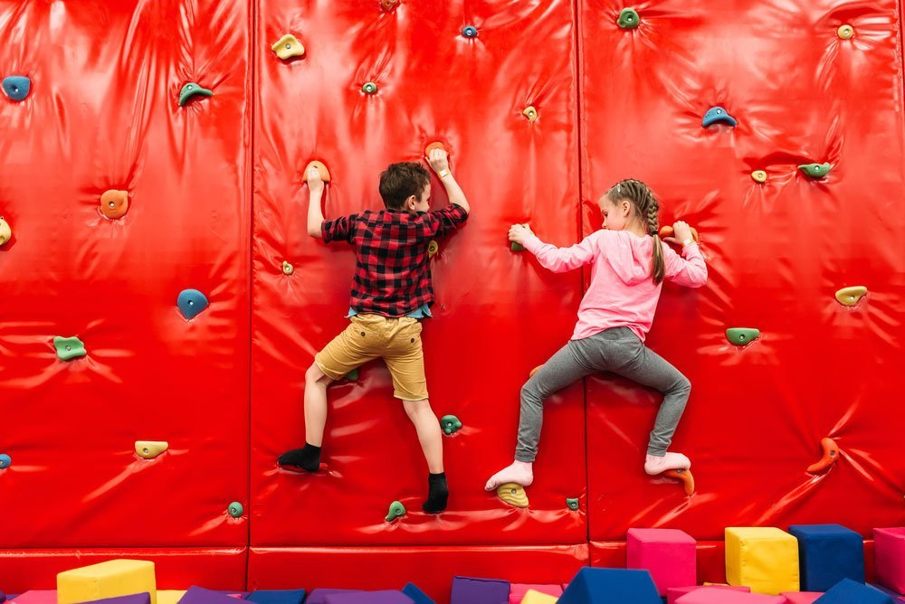 Kids on climbing wall at party