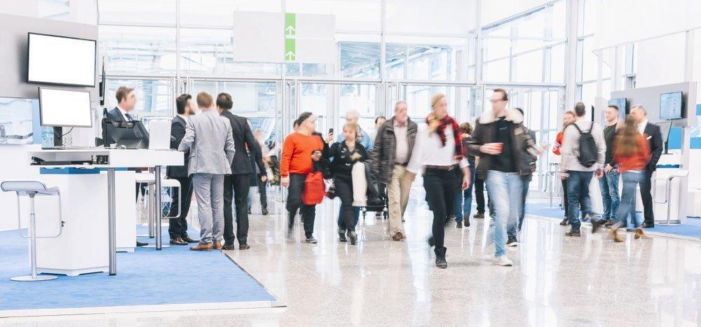 People walking through trade fair