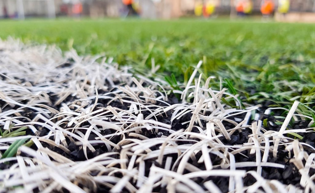 Close up of a synthetic grass soccer field