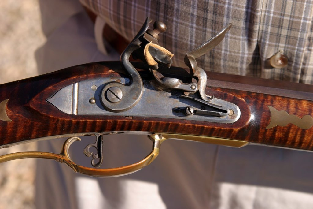 Close up picture of an antique gun's trigger
