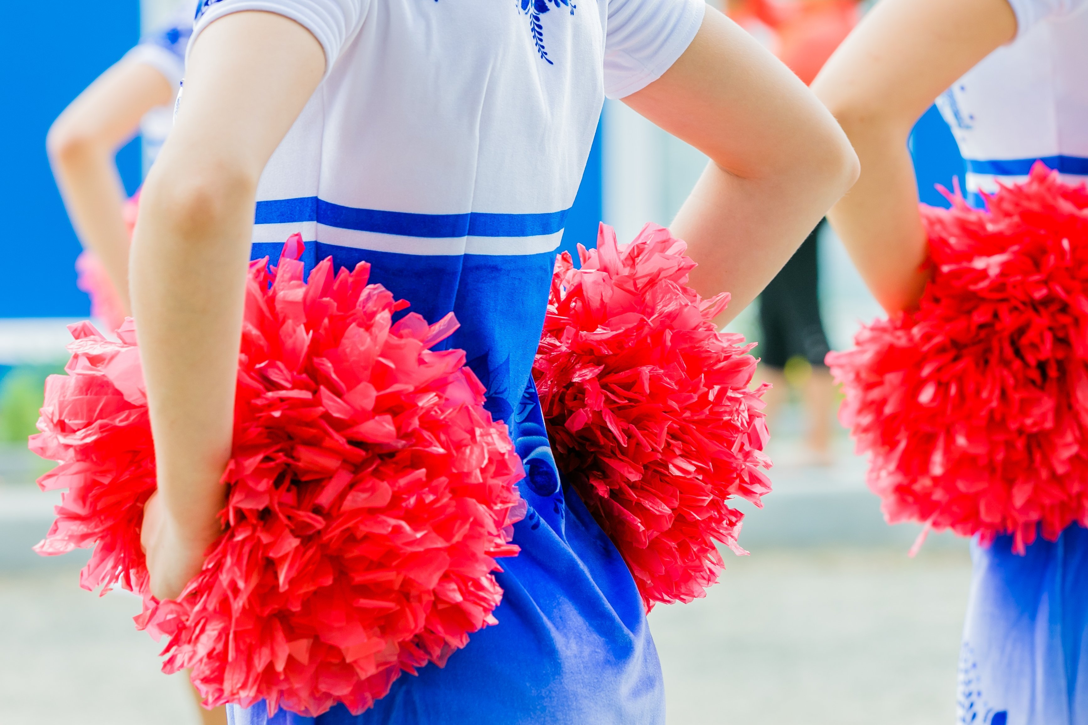 Cheer leader with hands on her hips