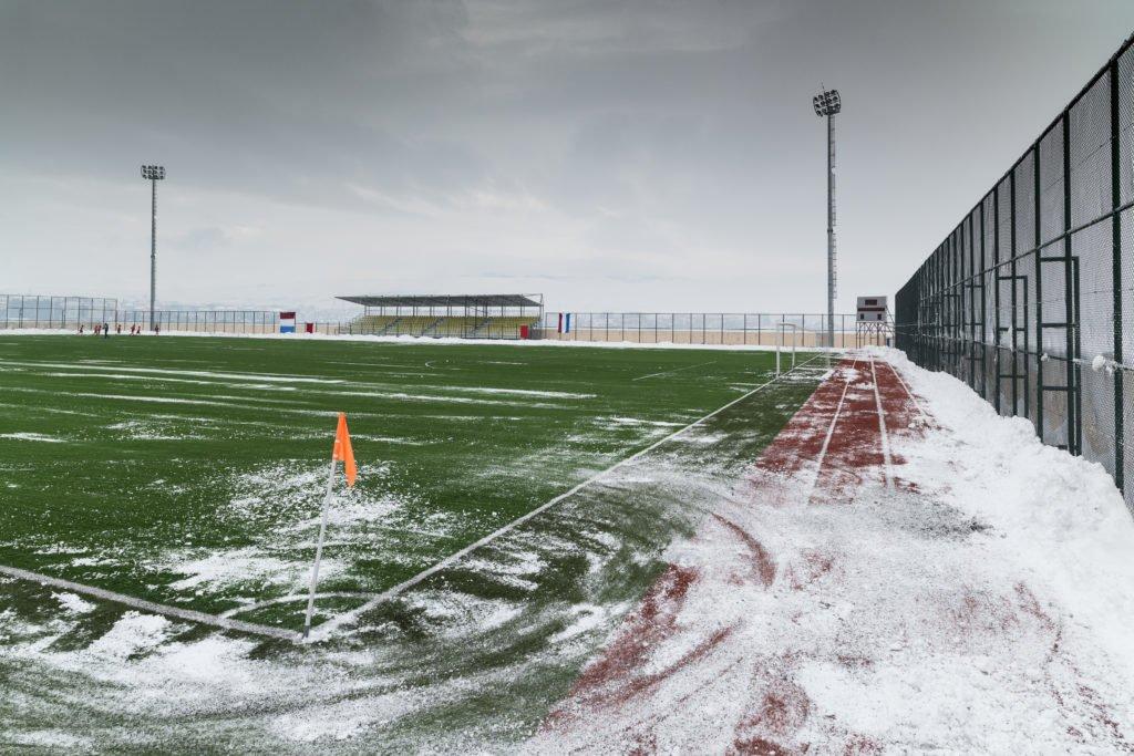 Snowy turf soccer field Hoover Met